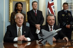 DEPUTY DEFENSE SECRETARY ENGLAND AND AUSTRALIAN MINISTER OF DEFENSE NELSON SIGN THE JOINT STRIKE FIGHTER MEMORANDUM