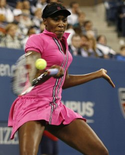 Venus Williams defeats Vera Dushevina in the first round at the US Open Tennis Championships in New York