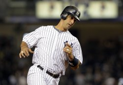 New York Yankees Jorge Posada hits a 2-run homer at Yankee Stadium in New York