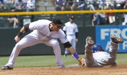 Rockies Tulowitzki Tags Out Mets Tejada on Stolen Base Attempt in Denver