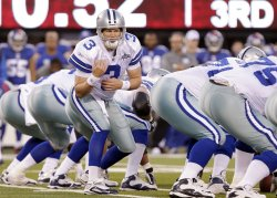 Dallas Cowboys Jon Kitna looks talks to the offense at New Meadowlands Stadium in New Jersey