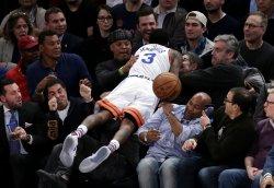 New York Knicks Brandon Jennings leaps into the crowd