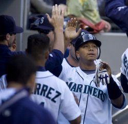 Seattle Mariners' Jose Lopez scores against the New York Yankees.