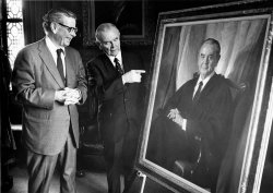 U.S. Supreme Court Justice William Brennan points to his portrait