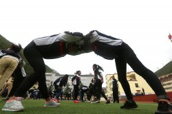 Tibetan students exercise at a new middle school in Ganzi Prefecture