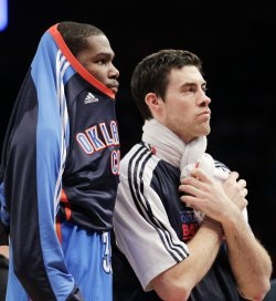 Oklahoma City Thunder Kevin Durant and Nick Collison (R) stand on the court at Madison Square Garden in New York