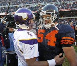 Vikings Favre and Bears Urlacher hug in Chicago