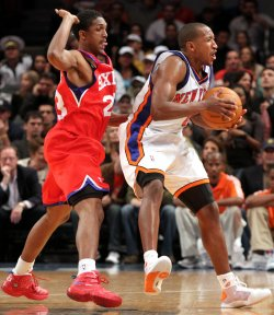 Philadelphia 76ers Louis Williams tries to strip the ball from New York Knicks Chris Duhon in the fourth quarter at Madison Square Garden in New York