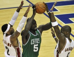 Celtics Garnett looks to pass against Cavaliers