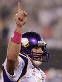 Minnesota Vikings quarterback Brett Favre reacts after throwing his 500th career touchdown pass at New Meadowlands Stadium in New Jersey