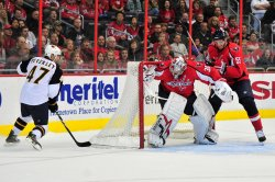 Capitals goalie Michal Neuvirth misses a block in Washington
