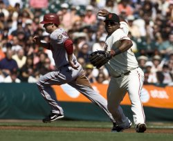 Pablo Sandoval throws out runner as the Giants sweep the Diamondbacks in San Francisco