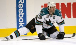 Sharks Thornton Stretches in Denver