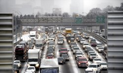 A winter snow storm snarls traffic and closes schools and businesses in Atlanta
