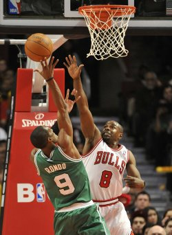 Celtics Rondo shoots as Bulls James defends in Chicago