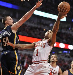 Bulls Rose shoots as Pacers Hansbrough defends in Chicago