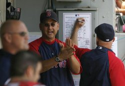Boston Red Sox manager Terry Francona claps in the dugout against the Chicago White Sox in Chicago