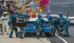Almirola pit crew springs into action for early stop.