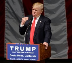 Donald Trump addresses a rally in Costa Mesa, California