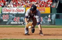 Atlanta Braves Adam LaRoche dives for baseball