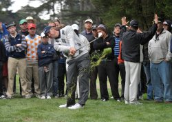Lucas Glover hits from the rough during the fourth round of the 2009 Presidents Cup in San Francisco