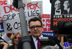 Dozens protest at News Corp.'s annual shareholders meeting in Los Angeles