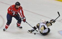 Capitals Fleischmann trips Penguins Redotenko in Washington