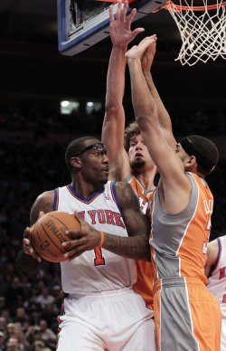 Phoenix Suns Robin Lopez (15) and Jared Dudley play defense on New York Knicks Amar'e Stoudemire at Madison Square Garden in New York
