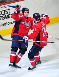 Washington Capitals' Boyd Gordon celebrates with teammate Brooks Laich in Washington