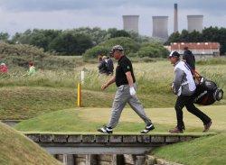 Darren Clarke walks over the water bridge during the Open Championship in England.