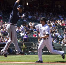 Rockies Helton Tags Out Braves Lee in Denver