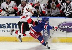 New York Rangers Brad Richards collides with Ottawa Senators Nick Foligno at Madison Square Garden in New York