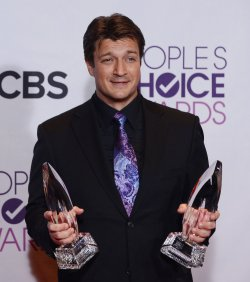 Nathan Fillion wins Favorite Dramatic TV Actor award at the 39th annual People's Choice Awards in Los Angeles