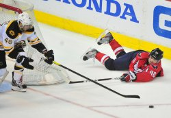 Marcus Johansson plays the puck from his stomach in Washington