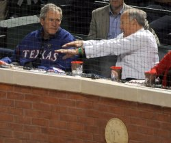 Texas Rangers' owner Nolan Ryan talks with former President George W. Bush during game 3 of the World Series