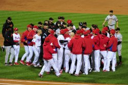 Members of the Phillies rush the mound during game 6 of the NLCS in Philadelphia