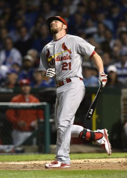 Cardinals' Brandon Moss is hit by a pitch in the NLDS in Chicago