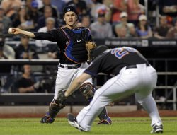 New York Mets Josh Thole throws to first base at Citi Field in New York