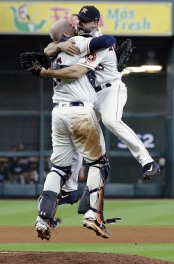Astros McCullers leaps into arms of McCann in the ALCS
