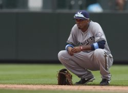 Brewers Shortstop Escobar Rests During Pitching Change in Denver