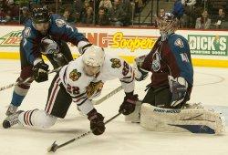 Avs O'Reilly Knocks Down Blackhawks Brouwer in Denver