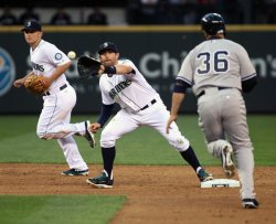 NEW YORK YANKEES BEAT THE SEATTLE MARINERS 3-2 IN SEATTLE.