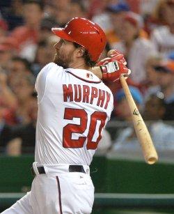 Nationals' Daniel Murphy is congratulated in Washington