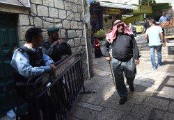 A Palestinian Passes Israeli Polce Old City Jerusalem