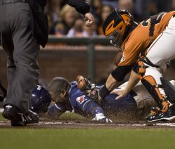 Padres Miguel Tejada tagged out at the plate in San Francisco
