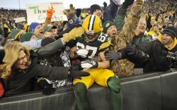 Packers Nelson does Lambeau Leap against Raiders in Green Bay, Wisconsin