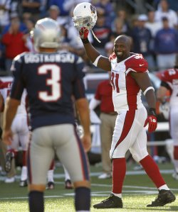Cardinals Holliday celebrates win over Patriots Gostkowski at Gillette Stadium in Foxboro, MA