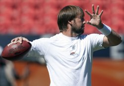 Denver Broncos Quarterback Kyle Orton Warms Up in Denver