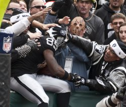 Raiders Darrius Heyward-Bey is mobbed in the stands in Oakland, California