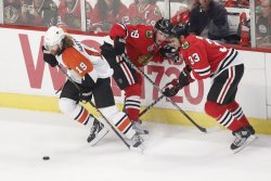 Flyers Hartnell Blackhawks Toews and Bufuglien go for puck during the 2010 Stanley Cup Final
